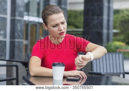 Busy Dissatisfied Angry Girl Sitting In A Cafe Outdors With Cup Of Coffee, Upset Sad Young Business