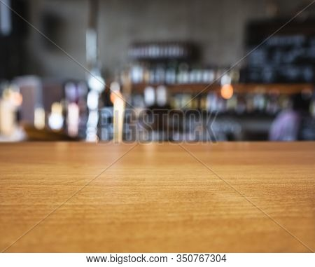 Table Top Wooden Counter Bar Witth Beer Tab Blur Background