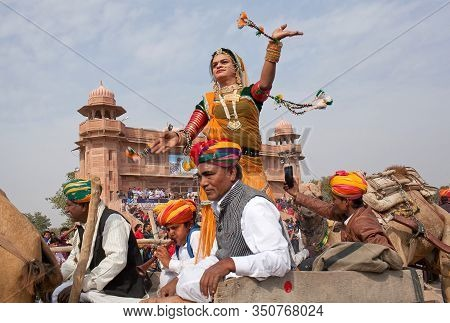 Bikaner, India - January 12, 2019: Indian Girl In Traditional Clothes Dancing On Camel Festival In R