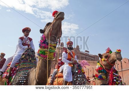 Bikaner, Rajasthan, India - January 11, 2020: Indian Warriors Riding On Camels During Camel Festival
