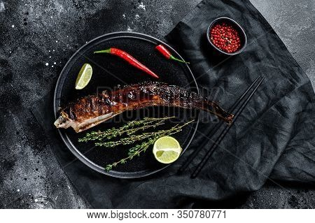 Japanese Grilled Eel With Teriyaki Sauce, Unagi. Black Background. Top View