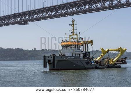 Lisboa, Portigal - April 2018: Industrial Vessel At Tagus River At The City Promenade