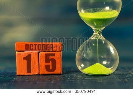 October 15th. Day 15 Of Month, Handmade Wood Cube With Date Month And Day And Hourglass With Green S