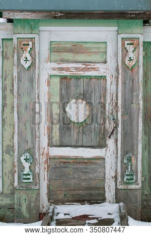 Old Wooden Wicket Door Of Residential Building With Carved Patterns And With Obsolete Paint Surface