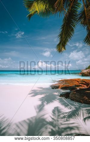 Exotic Tropical Beach. Pristine Crystal Clear Turquoise Ocean Water, Blue Sky And White Clouds. Summ