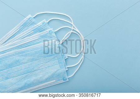 Medical Mask, Medical Protective Masks On Blue Background. Disposable Surgical Face Mask Cover The M