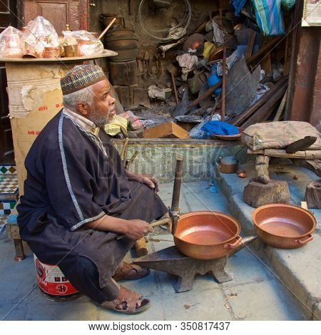 Fez, Morocco - November 2019: A Coppersmith Working In Souks In Fez Medina, Morocco