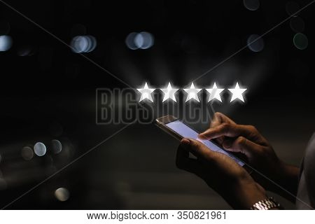 Businesswoman Pressing Five Stars (5) Rating On Virtual Touch Screen At Smartphone .customer Service