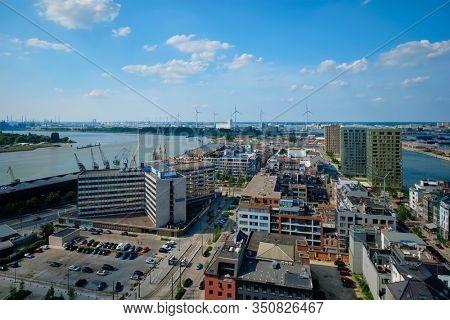 Aerial view of Antwerp city with port crane in cargo terminal. Antwerpen, Belgium. Benelux