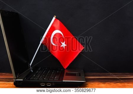 Flag Of Turkey , Computer, Laptop On Table And Dark Background