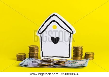 Accumulating Money For Your Home On A Yellow Background