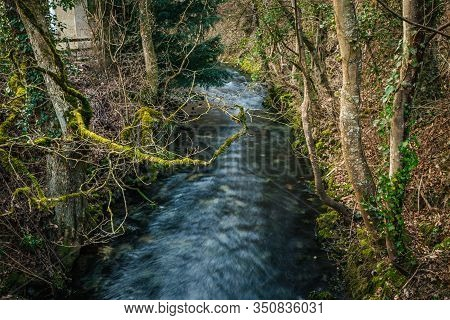 Small River 'blau' Near The Spring 'blautopf' In Blaubeuren. Long Exposure.