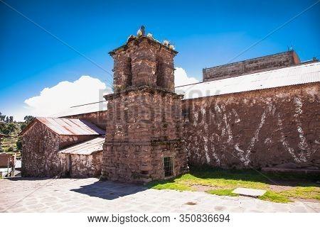 Church in a village on Taquile island in Titicaca lake, Peru. South America.