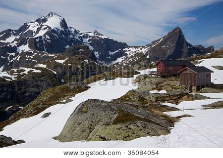 Mountain hut and highest peak of west Lofoten islands Hermannsdalstinden in the background in early summer poster