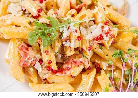 Penne With Meat Sauce Decorated On A Plate