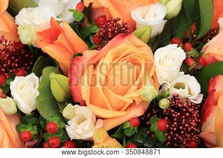 Orange Roses, Red Berries And Skimmia In A Big Wedding Centerpiece