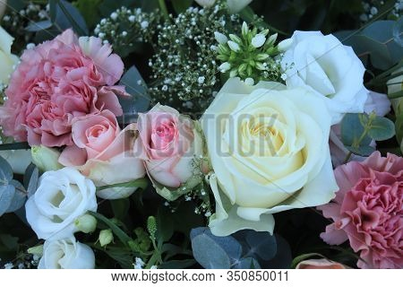 Pink And White Roses And Carnations In A Big Wedding Centerpiece