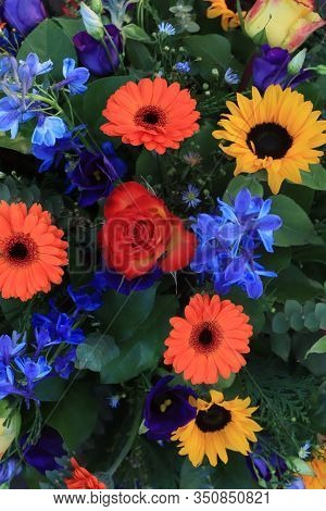 Colorful Bridal Flower Arrangement: Orange Gerberas, Yellow Roses, Sunflowers And Blue Larkspur