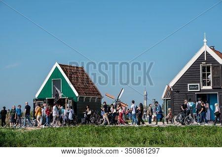 Zaanse Schans, Netherlands - October 30 2019: Tourist Masses And Crowds Filling The Little Dutch Vil