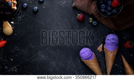 Top View Of Summer Dessert With Blueberry Flavour Ice-cream Cones On Black Desk Background