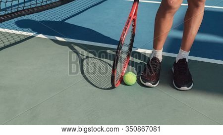Young Tween Preteen Boy Feet With Green Tennis Ball And Red Racket, Kid Sports, Active Healthy Child