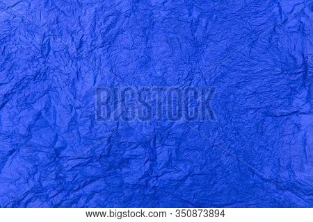 Abstract Textured Background. Blue Background. Texture Of Crumpled Blue Paper. Beautiful Blue Surfac