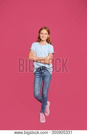 Full Length Portrait Of Preteen Girl On Pink Background