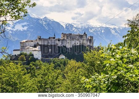 Salzburg, Austria - May 17, 2019: This Is Hohensalzburg Castle, Towering Above The City On Top Of Th