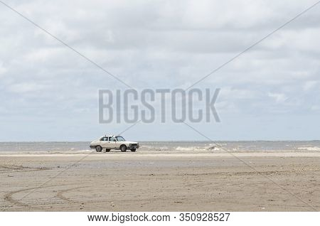 Punta Rasa, Buenos Aires / Argentina: Dec 31, 2015: Beach Landscape, A Car Standing In The Sand With