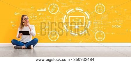 E-learning Concept With Young Woman Holding A Tablet Computer