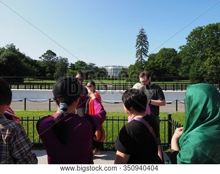 Washington D.c., Usa - June 3, 2019: Groups Of Tourists Pose And Take Photos Near The White House Se