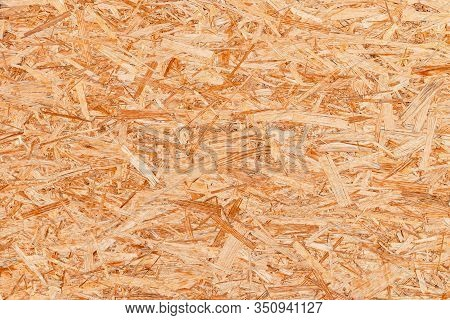 The Texture Of The Osb Material, The Recycled Pressed Wood Chips, The Texture Of Plywood. Close Up