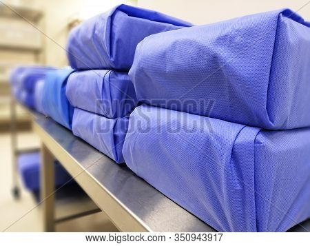 Blue Wrapped Sterile Surgical Instruments Containing Sets