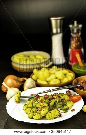 Homemade Gnocchi With Spinach And Prosciutto On Black Slate Board.  Traditional Italian Food. Potato