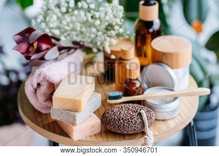 Set Of Natural Eco-friendly Bath Accessories On Wooden Table. Top View Shower And Bath Sponge, Luffa