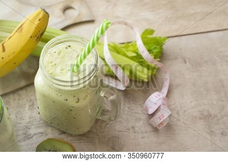 Healthy Green Juice Detox Coctail Or Smoothie With Measuring Tape. Glass With Paper Straw. Healthy E