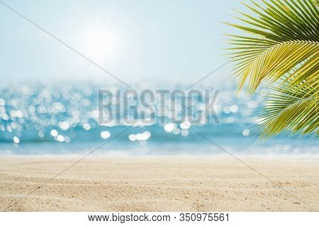 Beautiful Seascape Tropical Beach Background. White Sand With Palm Tree And Blur Bokeh Light Of Calm