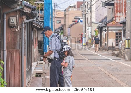 Tourists Are Walking In The Old Nishi Chaya District.