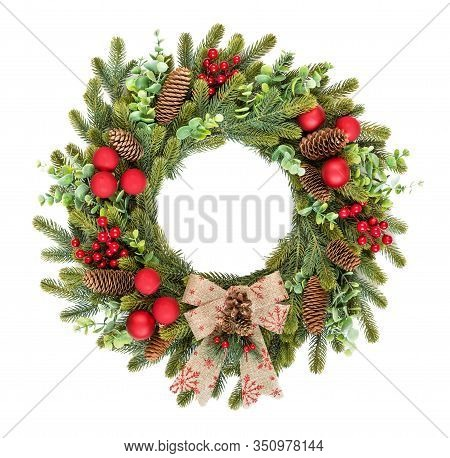 Traditional Rustic Christmas Wreath Of Green Spruce And Eucalyptus Branches, Decorated With Red Holl