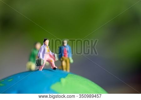 Miniature Figurine Group Of Young Traveler Traveling For Journey People In Trips Abroad Standing On