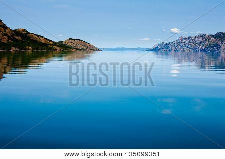Calm summer day on huge Lake Laberge Yukon Canada