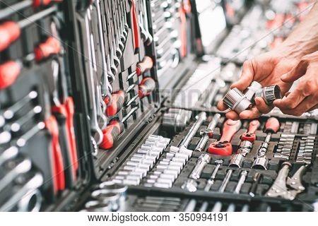 Engineer Tool Retail. Cropped Shot Of Handyman Choosing Instruments For Auto Repair.