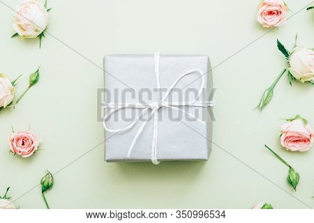 Holiday Present. Festive Occasion Surprise. Silver Gift Box On Floral Pattern Background.