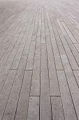 vertical lines of a worn wooden deck floor poster