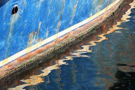 Old Blue Rusty Boat Still Sails In Sunny Day