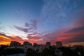 Beautiful Orange Sunset Over A Dark Cityscape.