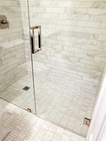 Modern Bathroom, Walk In Shower With A Floor That Is Flush With The Drain, All White Marble Tile