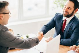 Successful Negotiation, Deal, Office Meeting. Business Partners Handshaking After Deal Or Interview.