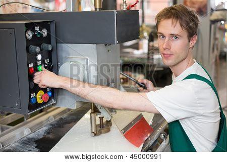 Worker Operates Glass Drilling Machine