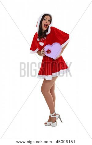 Young woman in a saucy Santa outfit